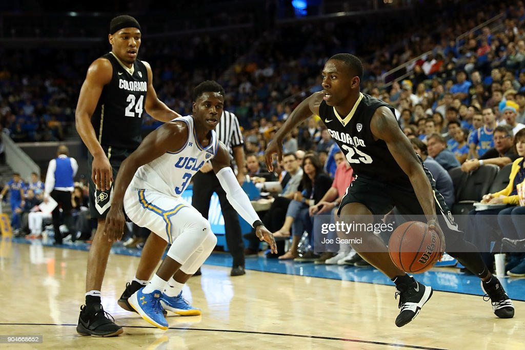 McKinley Wright IV #25 of the Colorado Buffaloes drives the ball around Aaron Holiday #3 of the UCLA Bruins and George King #24 of the Colorado Buffaloes in the second half of the Colorado v UCLA game at Pauley Pavilion on January 13, 2018 in Los Angeles, California.
