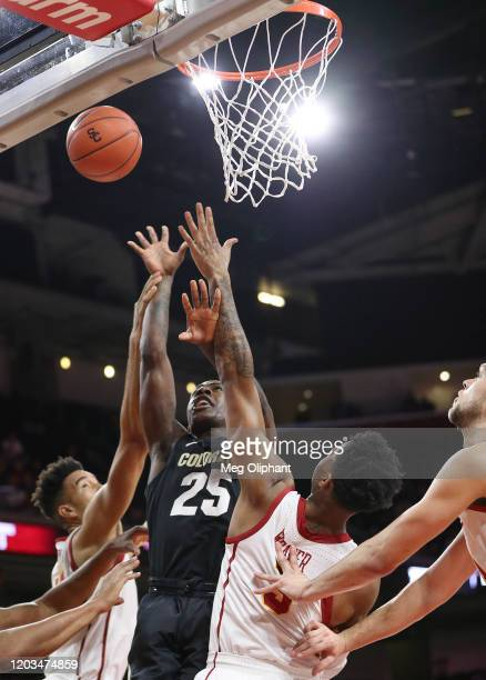 McKinley Wright IV of the Colorado Buffaloes takes a shot defended by Elijah Weaver and Isaiah Mobley of the USC Trojans at Galen Center on February...