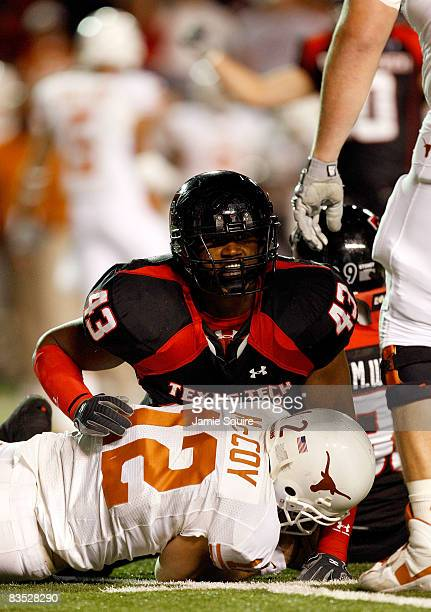 McKinner Dixon of the Texas Tech Red Raiders tackles sacks quarterback Colt McCoy of the Texas Longhorns during the first half of the game on...