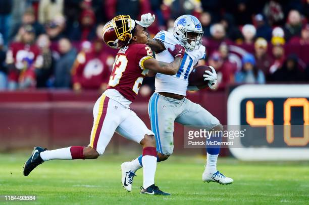 D McKissic of the Detroit Lions knocks off Quinton Dunbar of the Washington Redskins helmet in the second half at FedExField on November 24 2019 in...