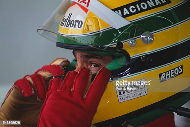 McLaren driver Ayrton Senna waits in his car before the start of the 1991 Canadian Grand Prix.