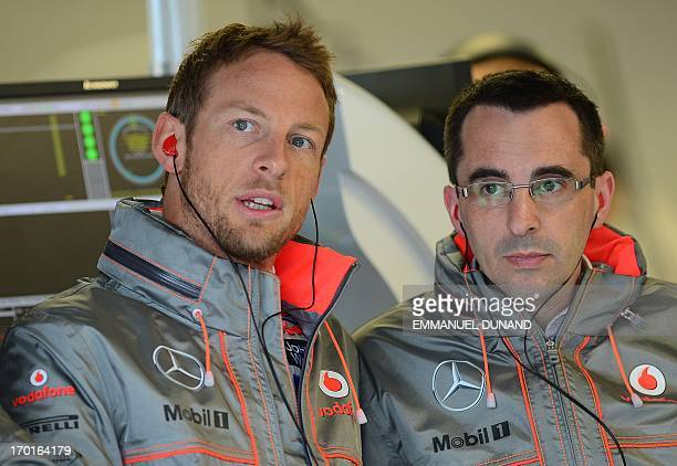McLaren driver Jenson Button of Great Britain talks with a technician during practice in the Canadian Formula One Grand Prix at the Circuit Gilles...