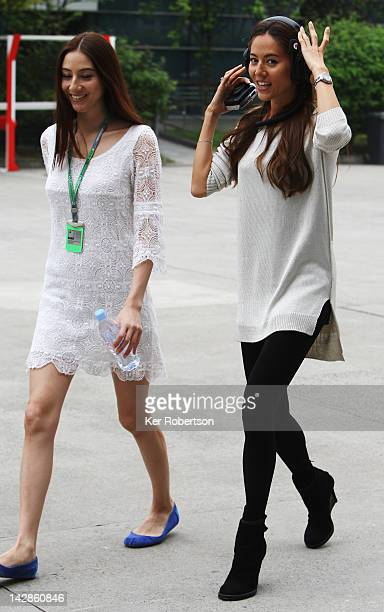 McLaren driver Jenson Buttons girlfriend Jessica Michibata with her younger sister Angelica Michibata walks in the paddock before qualifying for the...