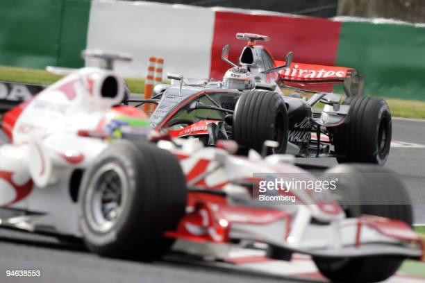 McLaren Driver Kimi Raikkonen is seen behind Super Aguri Driver Sakon Yamamoto during the first practice day for the Formula 1 Japanese Grand Prix in...