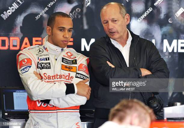 McLaren driver Lewis Hamilton of Great Britain speaks to team boss Ron Dennis during the first practice session of the Australian Grand Prix, in...