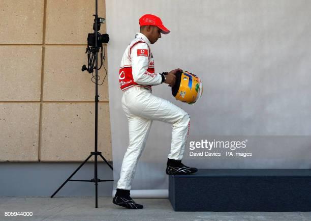 McLaren driver Lewis hamilton prepares to have his photograph taken during the Paddock Day at the Bahrain International Circuit in Sakhir Bahrain