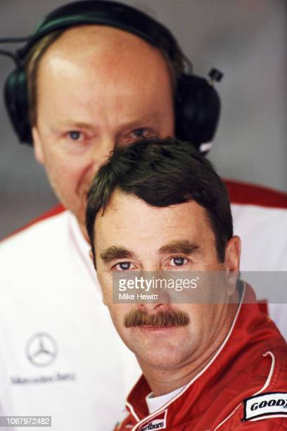 McLaren driver Nigel Manselll of Great Britain looks on during practice for the San Marino Grand Prix at the Autodromo Enzo e Dino Ferrari on April...