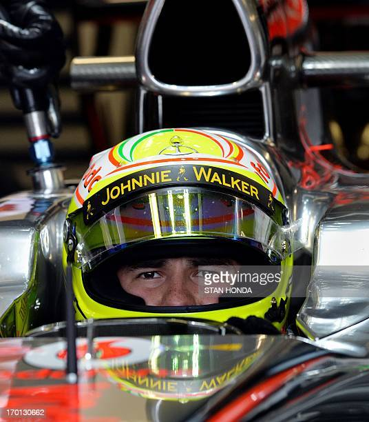 McLaren driver Sergio Perez of Mexico sits in his car during practice at the Canadian Formula One Grand Prix at the Circuit Gilles Villeneuve in...