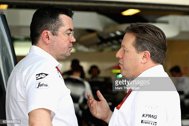 McLaren Executive Director Zak Brown and McLaren Racing Director Eric Boullier talk in the garage during practice for the Abu Dhabi Formula One Grand...