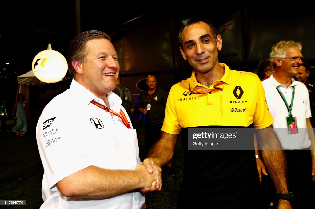 McLaren Executive Director Zak Brown and Renault Sport F1 Managing Director Cyril Abiteboul shake hands after announcing that McLaren will use Renault engines for the 2018 F1 season onwards after practice for the Formula One Grand Prix of Singapore at Marina Bay Street Circuit on September 15, 2017 in Singapore.