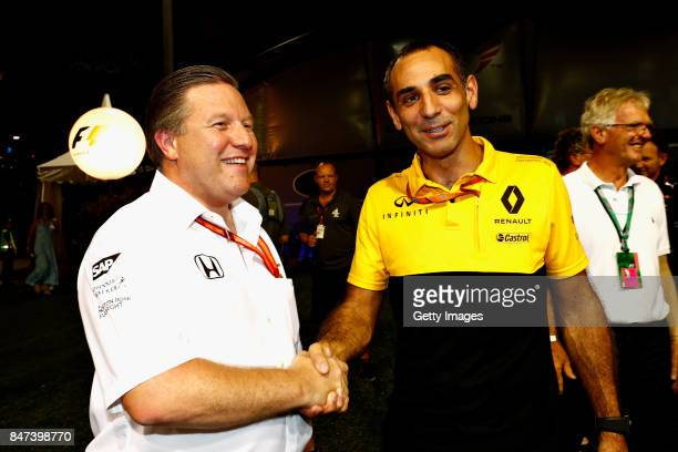McLaren Executive Director Zak Brown and Renault Sport F1 Managing Director Cyril Abiteboul shake hands after announcing that McLaren will use...