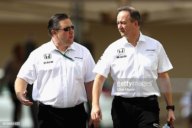 McLaren Executive Director Zak Brown talks with Jonathan Neale Chief Operating Officer of McLaren during practice for the Abu Dhabi Formula One Grand...