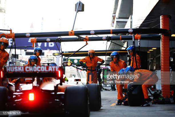 McLaren F1 team members prepare for Lando Norris of Great Britain driving the McLaren F1 Team MCL35 Renault to stop in the Pitlane during the F1...