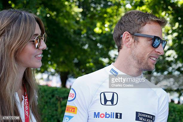 McLaren Formula One driver and 2009 World champion Jenson Button with his wife Jessica Michibata at Goodwood on June 27 2015 in Chichester England