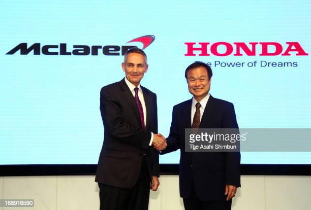 McLaren Group CEO Martin Whitmarsh and Honda Motor Co President Takanobu Ito shake hands during a press conference at Honda's headquarters on May 16...
