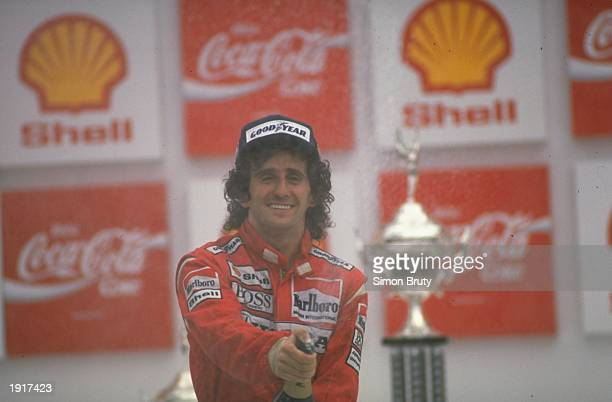McLaren Honda driver Alain Prost of France partakes in the traditional champagne celebration after his victory in the Brazilian Grand Prix at the Rio...