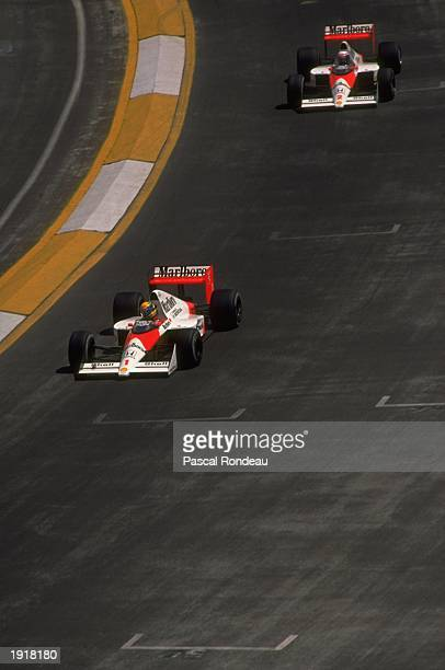 McLaren Honda driver Ayrton Senna of Brazil laps his team mate Alain Prost of France during the Mexican Grand Prix at the Mexico City circuit. Senna...
