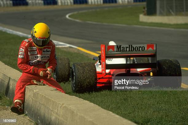 McLaren Honda driver Ayrton Senna of Brazil sits on a wall at the side of the track during the Spanish Grand Prix at the Jerez circuit in Spain Senna...
