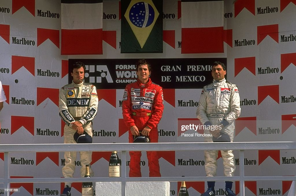 McLaren Honda driver Ayrton Senna (centre) of Brazil stands on the winners'' podium after his victory in the Mexican Grand Prix at the Mexico City circuit. \ Mandatory Credit: Pascal Rondeau/Allsport