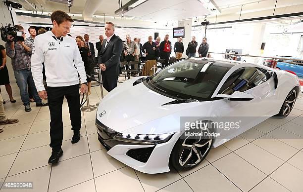 McLaren Honda F1 driver Jenson Button and Honda Australia Director Stephen Collins inspect the NSX concept vehicle at a Honda F1 Grand Prix press...