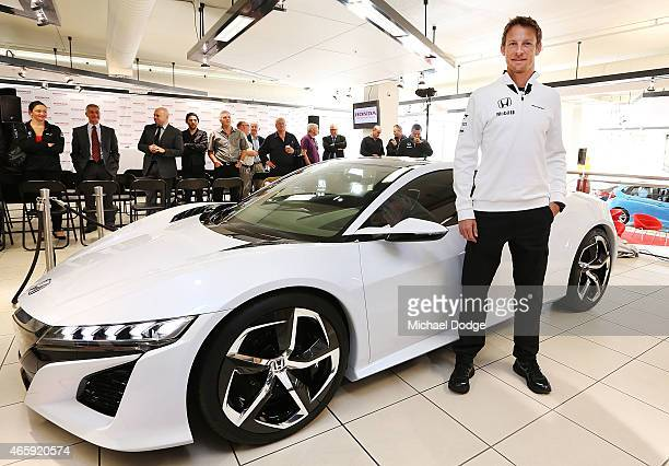 McLaren Honda F1 driver Jenson Button poses with the NSX concept vehicle at a Honda F1 Grand Prix press conference on March 12, 2015 in Melbourne,...
