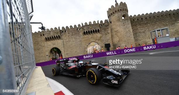 McLaren Honda F1 Team's Spanish driver Fernando Alonso steers his car at the Baku City Circuit on June 17 2016 in Baku during the first practice...