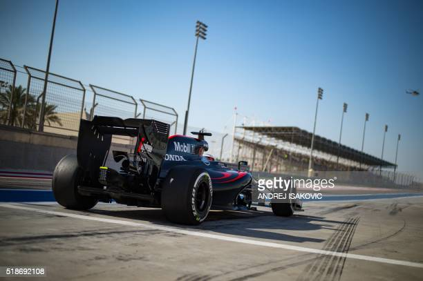 TOPSHOT McLaren Honda's British driver Jenson Button leaves the pit lane during the third practice session at the Sakhir circuit in Manama on April 2...