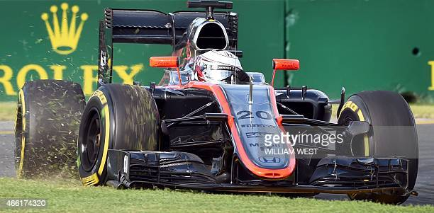 McLaren Honda's Danish driver Kevin Magnussen drives onto the grass during the qualifying round for the Formula One Australian Grand Prix in...