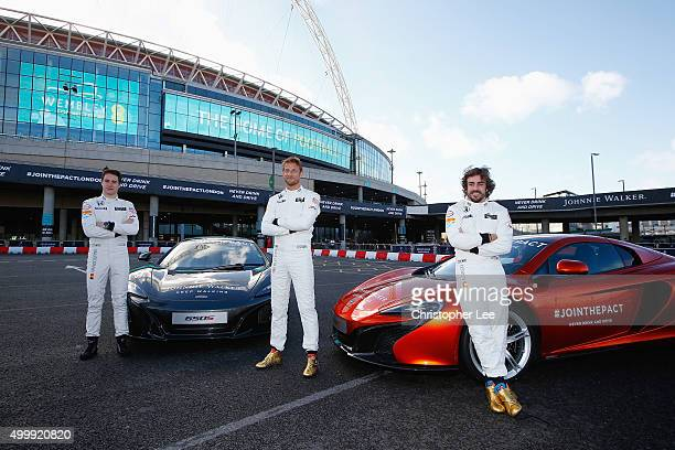 McLaren Hondas Jenson Button and Fernando Alonso and McLaren Honda Test Driver Stoffel Vandoorne pose for photographs outside Wembley Stadium on...