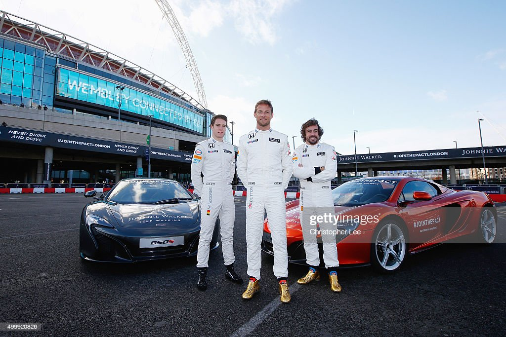 McLaren Hondas Jenson Button and Fernando Alonso and McLaren Honda Test Driver Stoffel Vandoorne pose for photographs outside Wembley Stadium on December 4, 2015 in London, England. The F1 stars are in London for the launch of the Johnnie Walker® festive responsible drinking initiative Join The Pact, to encourage people to make the pledge to never drink and drive. As part of the campaign, the Scotch whisky brand has pledged to give away 450,000 kilometres of safe rides home around the world this festive season. In addition, this year and starting in London, some people will have the opportunity to go one step further and experience the joy of festive giving by nominating a friend for a safe ride home. Join The Pact by visiting jointhepact.com or by tweeting #JoinThePact to @JohnnieWalker_.