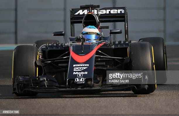 McLaren Honda's Spanish driver Fernando Alonso drives during the third practice session at the Yas Marina circuit in Abu Dhabi on November 28, 2015...