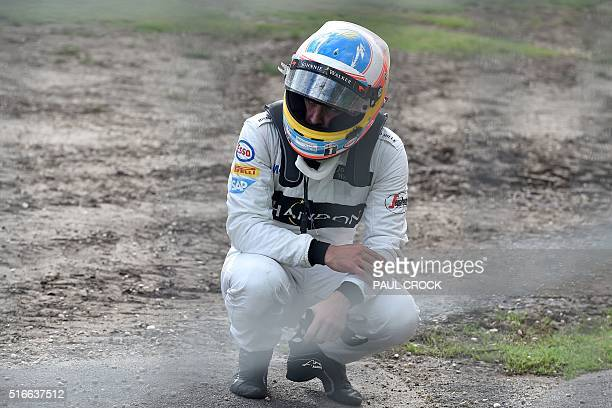 McLaren Honda's Spanish driver Fernando Alonso reacts after being involved in a crash with Haas F1 Team's Brazilian driver Esteban Gutierrez during...