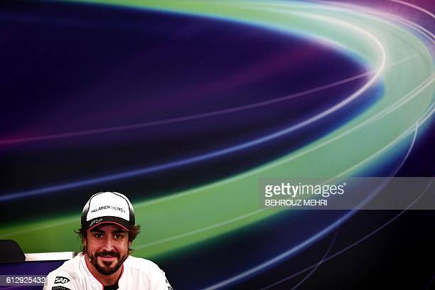 McLaren Honda's Spanish driver Fernando Alonso smiles during a press conference ahead of the Formula One Japanese Grand Prix in Suzuka on October 6...