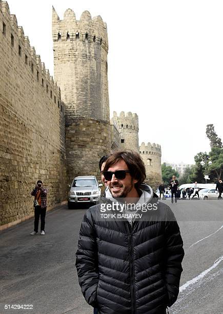 McLaren Honda's Spanish driver Fernando Alonso walks in downtown Baku on March 8 ahead of a Formula One Grand Prix to be held in the city for the...