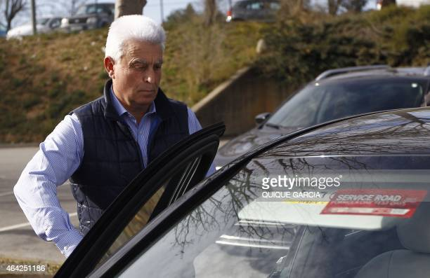 McLaren Honda's Spanish driver Fernando Alonso's father Jose Luis Alonso opens a car door as he leaves the General Hospital of Catalonia on February...