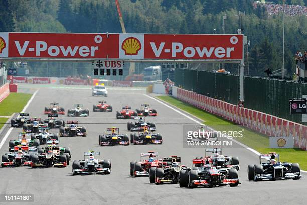 McLaren Mercedes' British driver Jenson Button leads at the start of racing at the SpaFrancorchamps circuit on September 2 2012 in Spa during the...