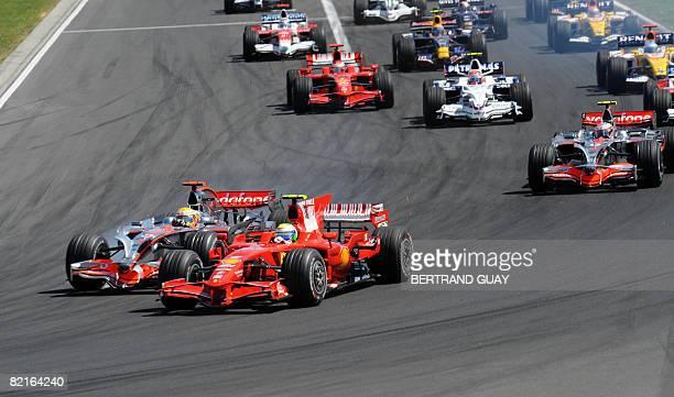 McLaren Mercedes' British driver Lewis Hamilton and Ferrari Brazilian's driver Felipe Massa take the start of the Formula One Hungarian Grand Prix at...
