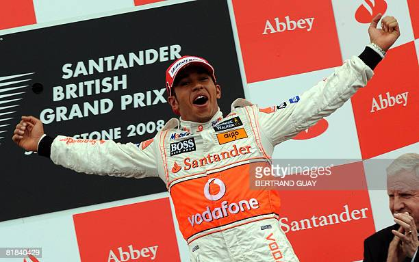 McLaren Mercedes' British driver Lewis Hamilton celebrates on the podium of the Silverstone racetrack on July 6, 2008 in Silverstone, England, after...