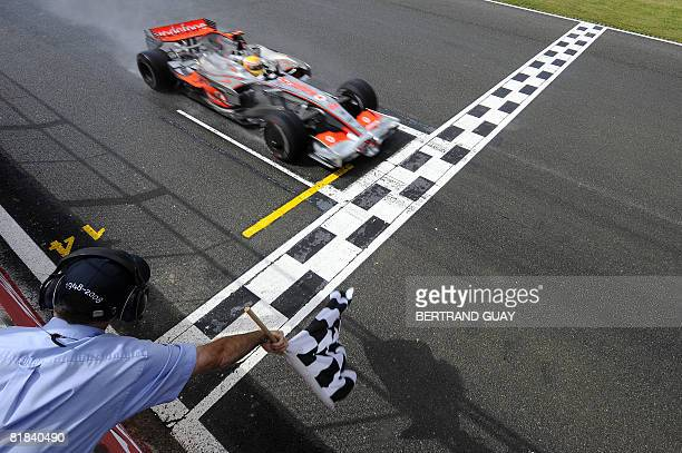 McLaren Mercedes' British driver Lewis Hamilton crosses the finish line at the Silverstone racetrack on July 6, 2008 in Silverstone, England, during...