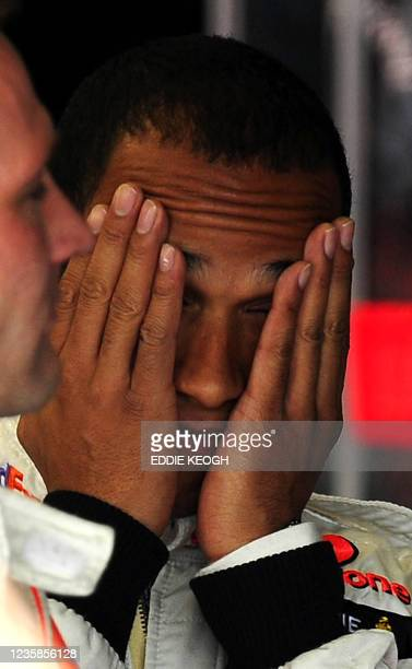McLaren Mercedes' British driver Lewis Hamilton gestures in the pits of the Silverstone racetrack on July 5, 2008 in Silverstone, England, during the...