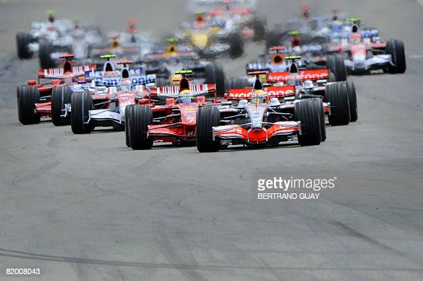 McLaren Mercedes' British driver Lewis Hamilton leads the start of the German Formula One Grand Prix at the Hockenheim ring racetrack on July 20 2008...