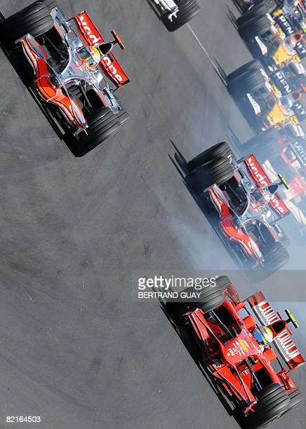 McLaren Mercedes' British driver Lewis Hamilton McLaren Mercedes' Finnish driver Heikki Kovalainen and Ferrari Brazilian's driver Felipe Massa take...
