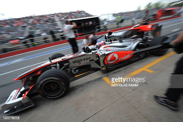 McLaren Mercedes driver Jenson Button of Britain leaves the pits during the third practice session of the Canadian Formula One Grand Prix in Montreal...