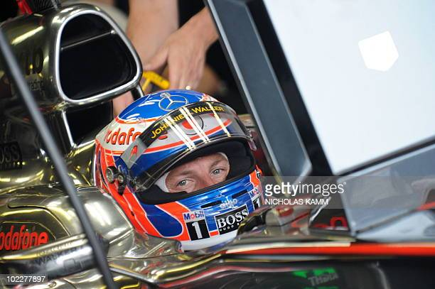 McLaren Mercedes driver Jenson Button of Britain prepares for the third practice session of the Canadian Formula One Grand Prix in Montreal on June...