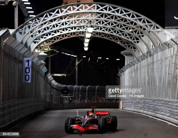 McLaren Mercedes' driver Lewis Hamilton drives over the Anderson Bridge during a practice session at the Marina Bay Circuit Park in Singapore