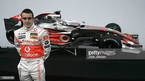 McLaren Mercedes driver twotime world champion Spain's Fernando Alonso poses at the unveiling of the new McLaren MP422 during the official team...