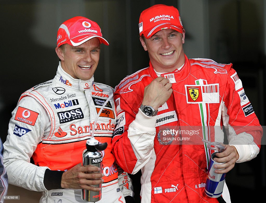 McLaren Mercedes' Finnish driver Heikki Kovalainen (L) and Ferrari's Finnish driver Kimi Raikkonen smile in the parc ferme of the Silverstone racetrack on July 5, 2008 in Silverstone, England, after the qualifying session of the Formula One British Grand Prix. McLaren Mercedes' Finnish driver Heikki Kovalainen clocked the best time ahead of Red Bull's Australian driver Mark Webber and Ferrari's Finnish driver Kimi Raikkonen.