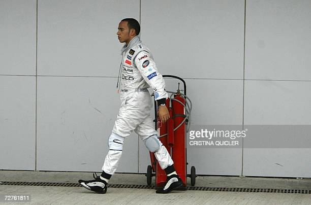 McLaren Mercedes Formula One driver Britain's Lewis Hamilton walks in the pits during a test session at the Jerez racetrack 07 December 2006Hamilton...