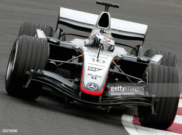 McLaren Mercedes Formula one driver Colombian Juan pablo Montoya takes a curve in his new car MP420 during the training session at the Catalonia...
