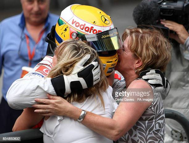 McLaren Mercedes' Lewis Hamilton celebrates his victory with his mother Carmen Lockhart and step mother Linda Hamilton during the Formula One Sinopec...